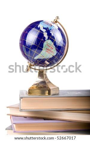 Globe on books isolated on a white background - stock photo