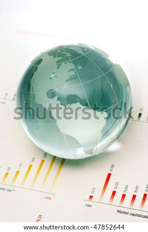 Globe on business document - stock photo