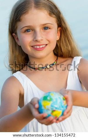 Globe on child hands, travel concept - stock photo