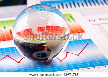 Globe on graphs - stock photo