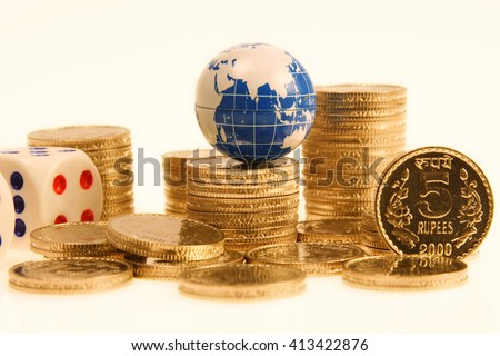 Globe on Indian rupee coins - stock photo