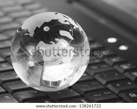 Globe on keyboard isolated on white - stock photo