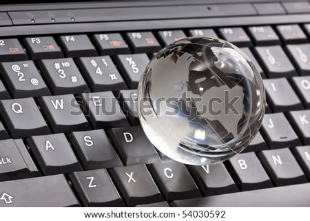 Globe on laptop keyboard