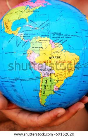 Globe on  man hand. - stock photo