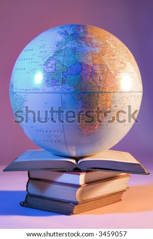 Globe on stack of books - stock photo