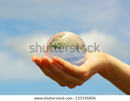 globe on the human hand - stock photo