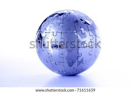globe puzzle on white - stock photo