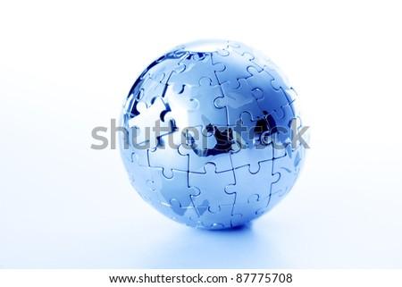 Globe puzzle on white - stock photo