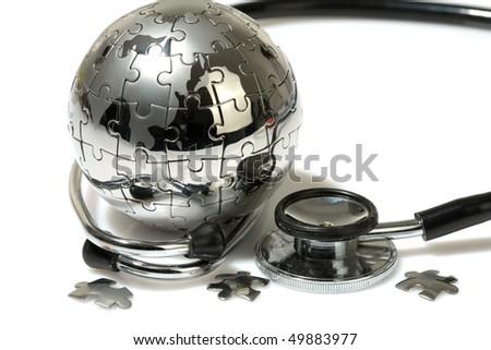 Globe puzzle on white background. Medical concept. - stock photo