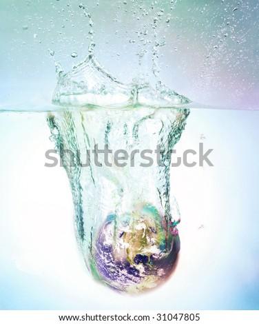 globe sinking in water - stock photo