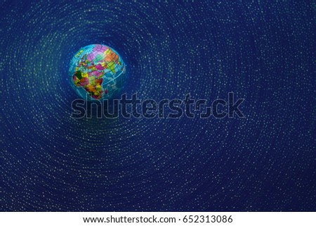Globe top view. Empty space for text. Simulation of the galaxy, starry sky.
