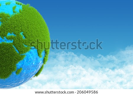 globe with green grass on background sky
