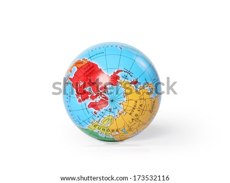 Globe, with the North Pole facing the camera, resting on a white background. - stock photo