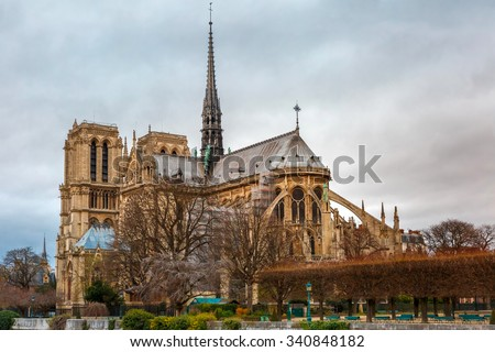 Gloomy cityscape with southern facade of Cathedral of Notre Dame de Paris in the winter day, France - stock photo