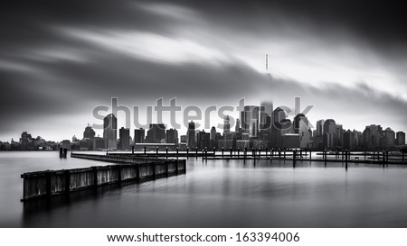 Gloomy Day for the Financial District: Fine Art black and white Lower Manhattan photo, taken from Jersey City across the Hudson River. - stock photo