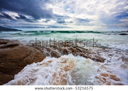 Gloomy weather on the tropical beach. - stock photo