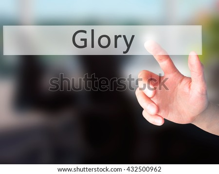 Glory - Hand pressing a button on blurred background concept . Business, technology, internet concept. Stock Photo