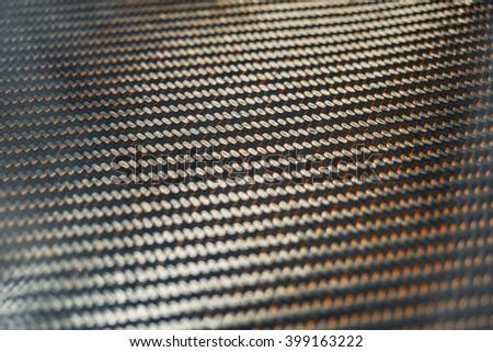 Glossy carbon fiber texture. Shallow focus.  - stock photo
