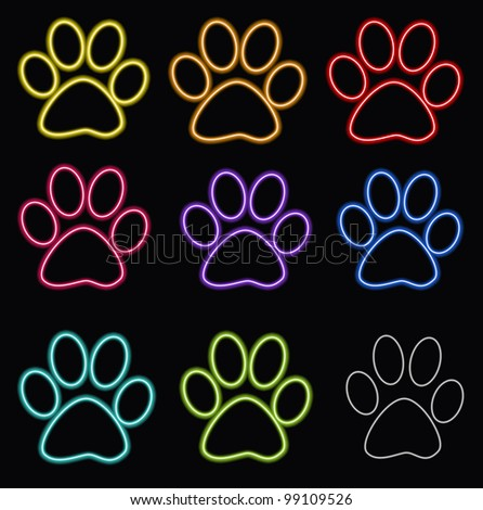 Glossy paw print on dark - stock photo
