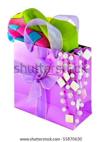 Glossy pink gift bag with silk scarf and pearl necklace, isolated on white