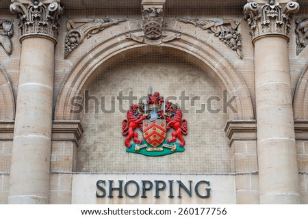 GLOUCESTER, UK - DECEMBER 04: Coat of Arms of the City of Gloucester on the facade of the Eastgate Shopping Centre on December 04, 2011 in Gloucester, UK. - stock photo