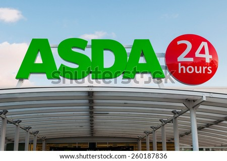 GLOUCESTER, UK - DECEMBER 07: 24 hours open Asda supermarket sign on December 07, 2011 in Gloucester, UK. Asda is the UK's second-largest chain by market share, with over 175,000 employees - stock photo