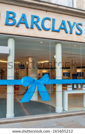GLOUCESTER, UK - DECEMBER 04: street view of Barclays bank branch on December 04, 2011 in Gloucester, UK. Founded in 1690, Barclays has operations in over 50 countries and has around 48 M customers. - stock photo