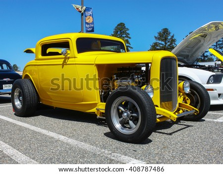 GLOUCESTER, VA - April 16, 2016: A Canary yellow Hot rod at the Daffodil car show with different lighting, the Daffodil car show is held once each year after the  Daffodil parade and festival.