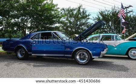 GLOUCESTER, VA - JULY 9, 2016: A Blue Oldsmobile Cutlass 442 at the Collector Car Appreciation Day Car Show sponsored by the Middle Peninsula Classic Cruisers car club.