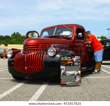 GLOUCESTER, VA - JULY 9, 2016: A burgundy 1941 Chevrolet AK Pickup at the Collector Car Appreciation Day Car Show sponsored by the Middle Peninsula Classic Cruisers car club.  - stock photo