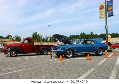 GLOUCESTER, VA - JULY 9, 2016: A Ford Mustang and a Chevrolet truck at the Collector Car Appreciation Day Car Show sponsored by the Middle Peninsula Classic Cruisers car club.  - stock photo