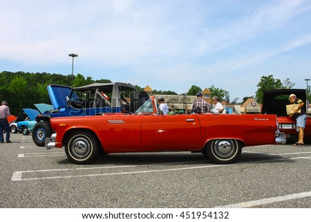 GLOUCESTER, VA - JULY 9, 2016: A red Ford Thunderbird convertible at the Collector Car Appreciation Day Car Show sponsored by the Middle Peninsula Classic Cruisers car club.  - stock photo