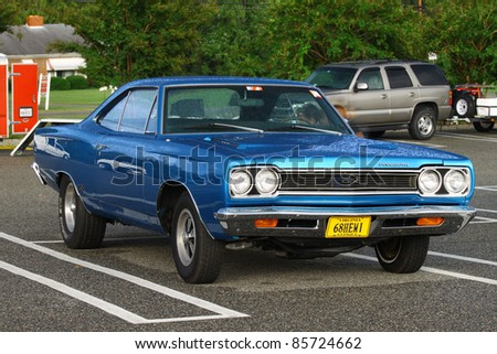 GLOUCESTER, VA, USA -SEPTEMBER 30: A vintage 1968 Plymouth GTX on display in the Middle Peninsula Classic Cruisers Club weekly Car Show at the Main Street Center on September 30, 2011 in Gloucester, VA, USA - stock photo