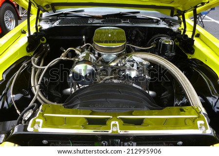 GLOUCESTER, VIRGINIA - AUGUST 23, 2014:A Canary yellow split bumper Chevy Camaro engine in the DRIVE-IN FOR DIABETES CAR SHOW Sponsored by Tractor Supply in August in Gloucester Virginia. - stock photo
