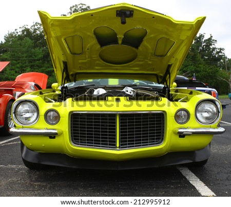 GLOUCESTER, VIRGINIA - AUGUST 23, 2014:A Canary yellow split bumper Chevy Camaro in the DRIVE-IN FOR DIABETES CAR SHOW Sponsored by Tractor Supply in August in Gloucester Virginia.  - stock photo