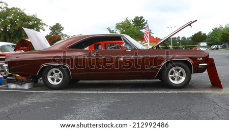 GLOUCESTER, VIRGINIA - AUGUST 23, 2014:A Chevy Impala Super Sport in the DRIVE-IN FOR DIABETES CAR SHOW Sponsored by Tractor Supply in August in Gloucester Virginia. - stock photo