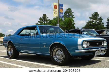 GLOUCESTER, VIRGINIA - JULY 12, 2014: A Blue 1967 Chevrolet Camaro SS350 in the Blast from the PAST CAR SHOW,The Blast From the Past car show is held once each year in July in Gloucester Virginia. - stock photo