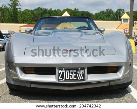 GLOUCESTER, VIRGINIA - JULY 12, 2014: A Chevrolet Corvette Stingray in the Blast from the Past  Car Show,The Blast From the Past car show is held once each year in July in Gloucester Virginia. - stock photo