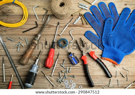 gloves and set of tools on a wooden table horizontal frame