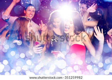 Glowing background against happy friends having fun together - stock photo