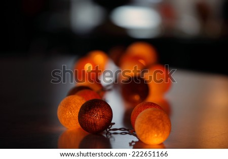 Glowing balls on the table, abstract background (shallower depth of field)