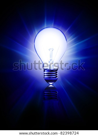 glowing blue bulb on a dark background - stock photo