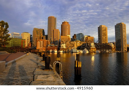 Glowing boston skyline at dawn - stock photo