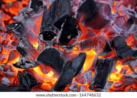 Glowing charcoal and flame - stock photo