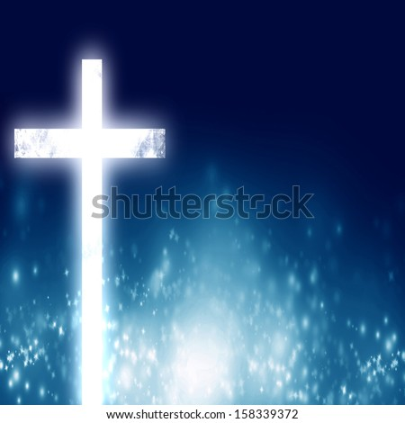 glowing christian cross on a blue background with some glitters - stock photo