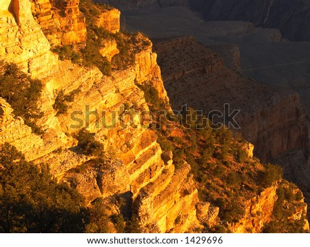 Glowing cliff at the Grand Canyon in morning sunlight