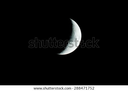 glowing crescent moon on black sky background
