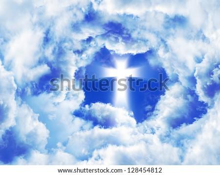 Glowing cross in a blue sky. Faith symbol. - stock photo