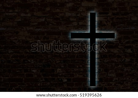 Glowing cross on a brick wall. Church background.