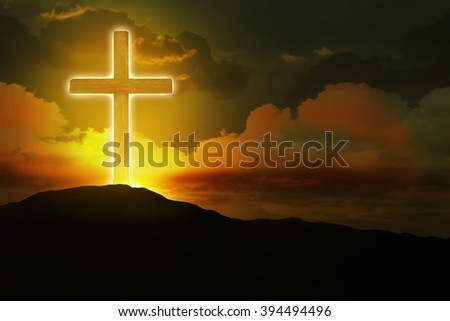 Glowing cross up to the hill - stock photo